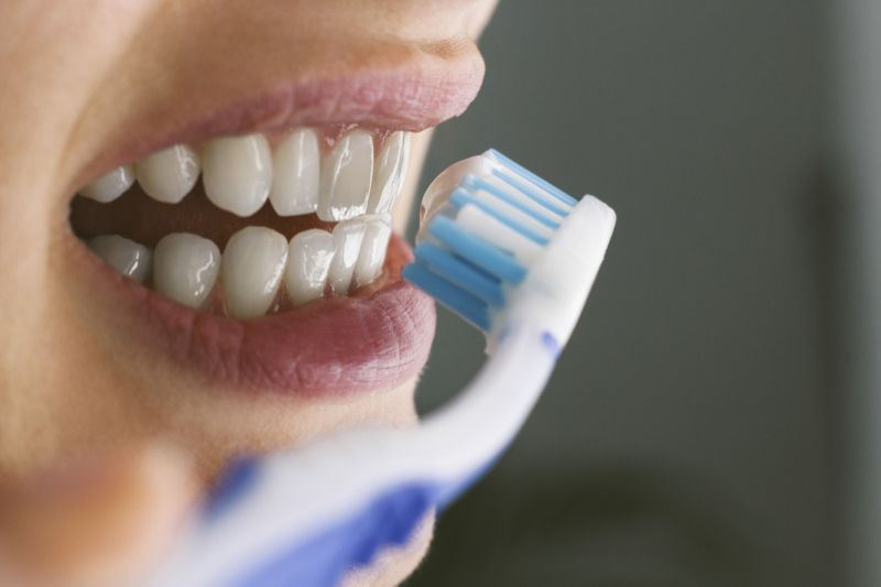 Brushing with toothpaste