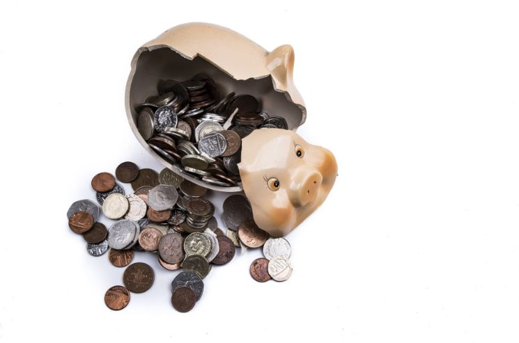 A smashed piggy bank with change